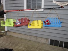porch swing bird feeders...seats are screened for the seed :)