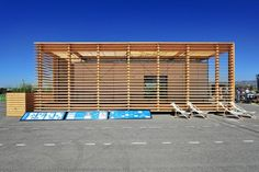View on southern facade with horizontal shading lamellas. In front of AIR House there are blue white signange panels with piktograms and sch...