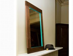 DIY Add a pop of color to drab mirrors