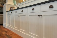 White Cabinets with Bronze Knobs and Cup Pulls. I think I would do a nickel finish instead of bronze, though.