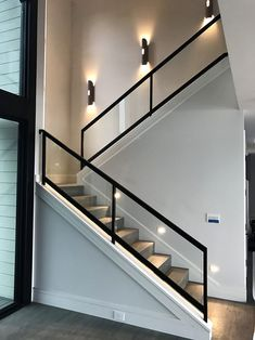 Steel and wooden staircases with a glass handrail lead to the second floor . - Steel and wooden stairs with a glass handrail lead to the second floor of this … – - Modern Stair Railing, Stair Railing Design, Staircase Railings, Wooden Staircases, Staircase Ideas, Staircase Remodel, Stairways, House Staircase, Stair Handrail