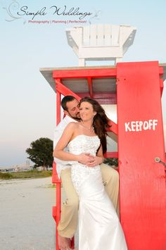 Keep Off! Wedding pictures on the lifeguard stand are a cute idea for your Florida beach wedding!