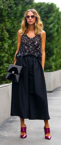 Black maxi skirts can definitely go from day to night with a few key pieces.