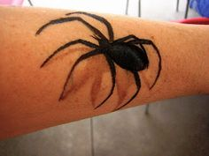spider face paint design cheek art