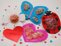 Spread a little love this  Valentine's Day  with sweet, handmade cards. Create your favorite flower or garden love bug and fill with candy for a charming gifts. These are great Valentine's Day treats for kids or adults with a sweet tooth!