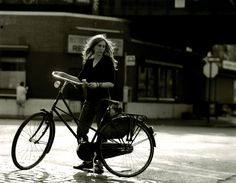 Patti and her bicycle. Meatpacking District, New York, NY. 1999. Credit: Steven Sebring