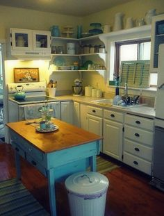 love the table and open shelves, but wait for it....I am envisioning it in pink! No, really.