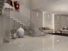 Sala y descanso de estilo contemporáneo. Materiales utilizados: (Muro): Porcelanato Contour Beige 33.3x100 de Porcelanosa (Piso): Mármol Blanco Arena GILSA en placas de 1.20x2.40