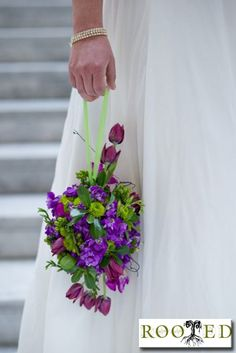 floral bridal pomander  of tulips, stock , kermit poms,  green hypericum berry and lisianthus by Rooted California