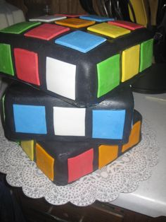 Rubix cube cake, made with fondant and buttercream.