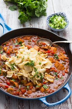 Mexican Chicken Enchilada Skillet Recipe — This comes together in one pot & is ready in under 30 minutes. This dish has so much bold flavor that no one will never know it only took you minutes to prepare. Top with the corn tortilla squares, green onions, & cilantro. Serve with a side of sour cream (optional)!