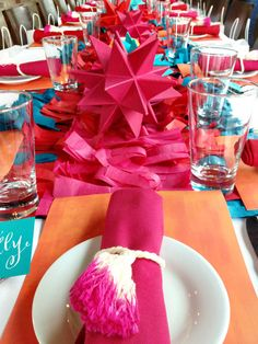 Dip Dye Tassel Napkin Rings | Hank & Hunt  These napkin rings couldn't be easier to make, and can really bring together your dinner party. I love the look of this table setting and how easy it would be to re-create - all you would need is the paper stars (which I'm sure you could find directions for online) and cut up pieces of crepe paper. Check out your local craft or sewing store for tassels, or even two dollar shops.