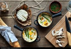 Cocotte with asparagus and mushrooms. - stock photo