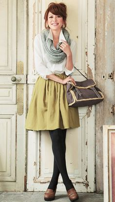 Black tights, yellow skirt, white top, grey infinity scarf and penny loafers