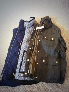 Vests and olive green jacket.