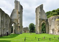 the ruins dominated by two tall, finger-like fragments that give a certain desolate symmetry to this once-majestic structure. Glastonbury Abbey, British Countryside, Secret Places, Barcelona Cathedral, Notre Dame, Jesus Christ, Medieval, The Past, England