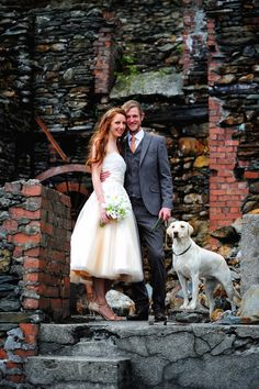 A Handmade Wedding in The Lake District. Bride and groom with dog. Image by Darren Athersmith Photography. Read more: http://bridesupnorth.com/2015/11/02/aint-no-mountain-high-enough-a-handmade-wedding-in-the-lake-district-emily-neil/