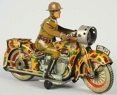 Tin Wind Up Toys | Lot # : 123 - Tin Litho Motorcycle Wind-Up Toy.