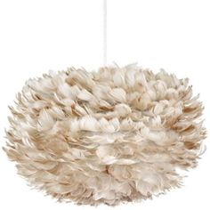 Thousands of goose feathers surround the bright core of the UMAGE Eos Brown Pendant, a design that is a statement of humane practices and sustainable production. The feathers are procured responsibly, sanitized and repurposed for the fixture, then attached to the paper structure on the inside. The Eos is fire-resistant and easily maintained; you can clean and revitalize the feathers with a hair dryer.