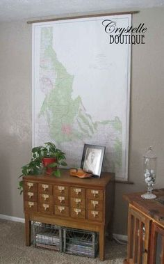 How to hang a large school map:  easy and cheap.    Make it look like a vintage pull-down map.  Crystelle Boutique