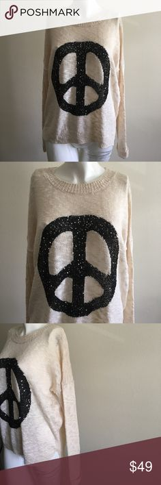 Peace (Light) Sweater by Elan This light sweater is great for a summer night with shorts or jeans. 90% Acrylic / 10% Polyester elan Sweaters Crew & Scoop Necks