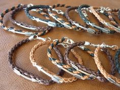 Order of the silver arrow bracelet, hand braided deerskin with silver arrow woven into the pattern. $15 ea.