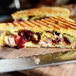 Pioneer Woman - Thanksgiving leftover panini with turkey, dressing, cranberry sauce, gravy, and mustard. The mustard cuts through all the flavors and adds a nice tang.