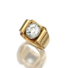 18 KARAT GOLD AND DIAMOND RING, FRENCH, CIRCA 1940. Centering an old European-cut diamond weighing approximately 4.00 carats bezel-set in platinum between scrolling shoulders in a sculpted mounting of rose gold, size 8¾, French assay marks.