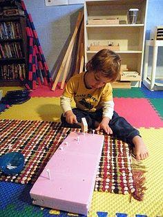 Keeping a toddler busy--Hammer golf tees into styrofoam