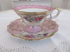 lovely pink and white vintage tea cup with roses