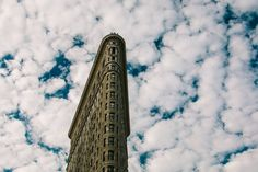 """Artistic photography for the home.  Title: """"Flatiron Building with Clouds""""   Signed photographic print Size: 12"""" x 8"""" UNFRAMED signed and dated on the back.  Materials: Printed on archival quality paper with lustre finish in a professional photo lab.  Additional sizes are available. Please contact me for details. Pricing is:  4"""" x 6"""" - $8 5 x 7 - $15 (This translates to 5 x 7.5, but can be cropped to get to get to standard 5 x 7—you get final approval before buying) 8 x 12 - $25 11 x 14…"""