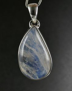 Beautiful good quality cabachon of Rainbow Moonstone mounted in sterling silver This is unique item you get what is on the picture Free gift box included Setting silver Sterling silver Dimension mm 33 x 14 x 7 mm overall size including setting/bail Weight