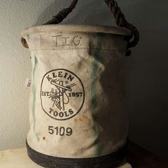 Vintage Klein tool bucket. Canvas with rope handle and plastic bottom. Made for linemen working with high voltage electricity. We have many more vintage tool items in Dallas at Vintage, neon soda sign. All original Doesn't work, but still has a great industrial vibe. See more of our old signs at Benny Jack Antiques and Lula B's Antique Mall.
