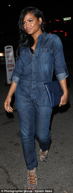 Coveralls: The Like Me singer covered up in a blue denim jumpsuit, which she paired with a matching envelope clutch and snakeskin lace-up heels