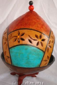 Gourd Bird Feeder... Wood burned with cut-outs. Pained with alcohol inks & acrylics. Created by Lani Walton 2014