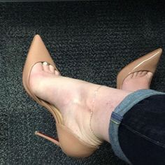 Beige pumps, arches, anklet, and toe cleavage