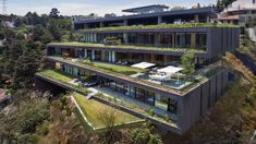 Grass terraces zigzag up Alcazar de Toledo apartments in Mexico City