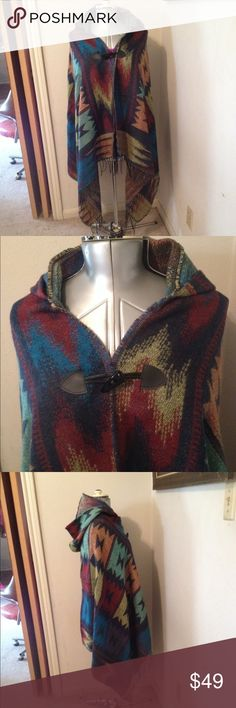 "Geometric Hooded Poncho Wrap Cape Multicolored geometric design with fringe and loop closure. Acrylic. Approximately 70"" x 30"" Fallinup Sweaters Shrugs & Ponchos"
