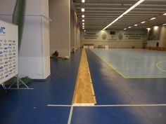 First row laying of assembled parquet provided by the DR brand to sports hall in Bucharest
