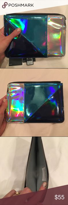 Marc by Marc Jacobs Metallic Clutch/Tech Case Vibrant metallic blue and holographic silver tech case (but I used it as a clutch!) by Marc by Marc Jacobs. Zipper closure and sturdy protective sides. A couple faint surface scratches, but overall excellent condition. Includes original tags. Marc by Marc Jacobs Bags Clutches & Wristlets