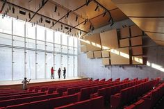 Natural light permeates the auditorium via a light well. The cant of the wall was calculated to bring in the greatest amount of natural light. Theatrical lighting is suspended from the ceiling along with Piano's Le Perroquet fixtures, which are fitted with a 28W 3000K LED module.