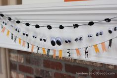 """oh I am so doing this! """"This googly eye garland is just plain Halloween genius! so fun!"""""""