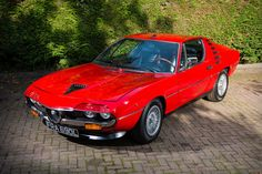With a sleek body from Marcello Gandini at Bertone and a powerful, 2.6L dry-sump V8 engine, 1972 Alfa Romeo Montreal