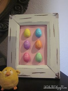 Adorable Antics Hot glue half of eggs on a paper and frame!