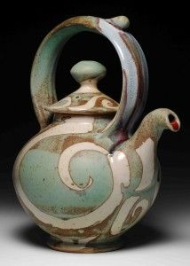 This lovely pottery teapot is so graceful. I love the melding of colors.