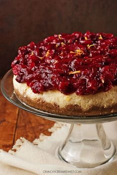 Cranberry Orange Cheesecake - sweet and creamy orange cheesecake with cranberry sauce. This cheesecake is perfect finish to your Christmas dinner!