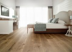 Calabria VCC-804  The Calabria is crafted using European white oak to produce a unique smoked finish that penetrates deep into the wood offering rich colors that cannot be duplicated by the usual top-staining process. Featuring 9.5-inch wide planks with a smooth finish and kissed edges, this engineered hardwood floor is capable of sustaining heavy foot traffic.