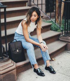 50 Jeans Outfits to Copy This Fall | light-wash mom jeans with frayed hems, styled with a sleeveless turtleneck and menswear-inspired loafers