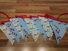 Reindeers and candy cane Christmas bunting from Nanny Buntings on Facebook Christmas Bunting, Buntings, Candy Cane, Reindeer, Advent Calendar, Facebook, Holiday Decor, Home Decor, Bunting Garland