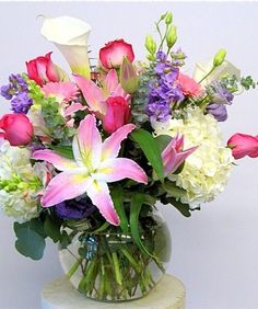 Pastel Bowl. A beautiful, large bowl of elegant flowers. Comprised of flowers such as lilies, gerbera, callas, roses, hydrangea and snap dragons.